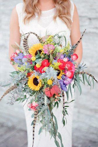 wildflower wedding bouquets cascading boho with sunflowers greenery and feathers laura ivanova photography