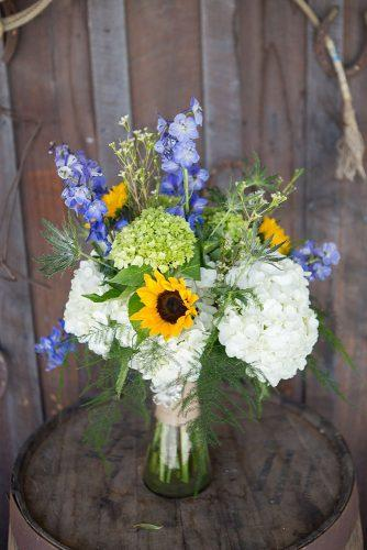 wildflower wedding bouquets small with white and blue flowers and sunflowers smith studios photography