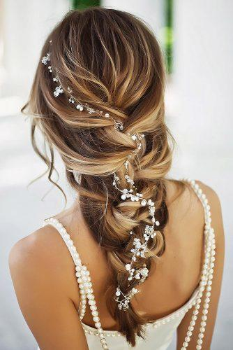bridal hairstyles cascading bride with accessorie on long hair bridesroom via instagram