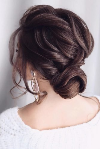 bridal hairstyles curly swept low bun on medium brown hair tonyastylist