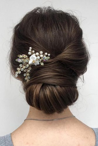 bridal hairstyles elegant low chignon with flower pin bridesroom via instagram