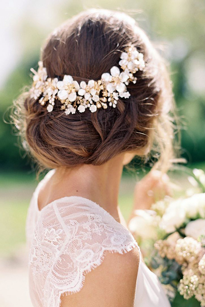 bridal hairstyles elegant low updo with a flower wreath amy fanton via instagram