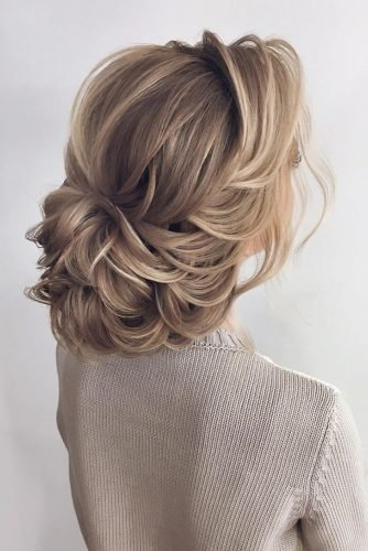 bridal hairstyles low updo elegant with waves on blonde hair kristina32_hair