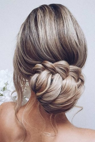 bridal hairstyles low updo on blonde white hair with braided texture hairbyhannahtaylor