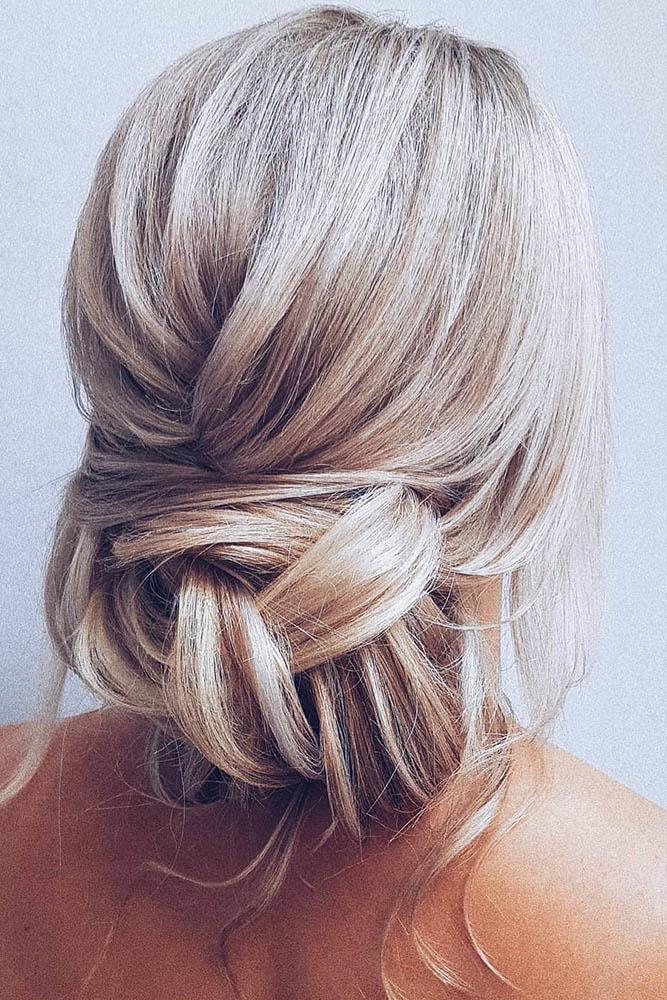 bridal hairstyles messy low bun on blonde hair with loose curls hairbyhannahtaylor