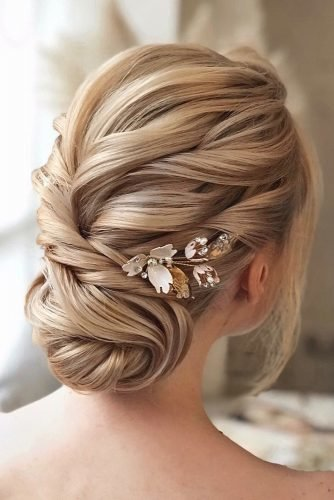 bridal hairstyles swept low updo on blonde hair with flower pins hair_vera