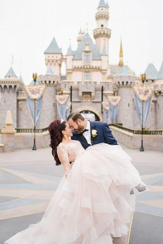 disney wedding amazing couple photo near disney castle