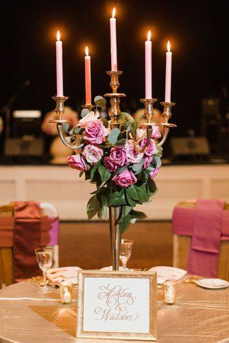 disney wedding centerpiece candelabrum with candles and pink roses beauty and the beast theme annamarie akins photography