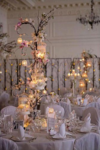 disney wedding centerpiece tall centerpieces with lighting candles and flowers firenzafloraldesign