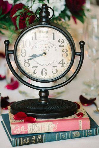 disney wedding centerpiece with books and clock michelle lange photography