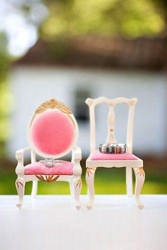 disney wedding rings on small pink chairs millie holloman photography
