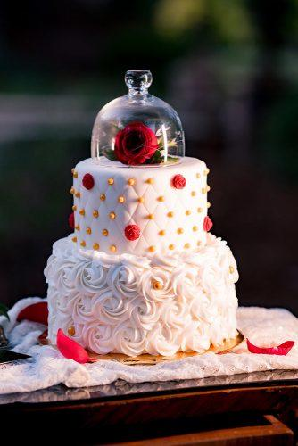 disney wedding white creamy with rose under glass raelyn elizabeth photography