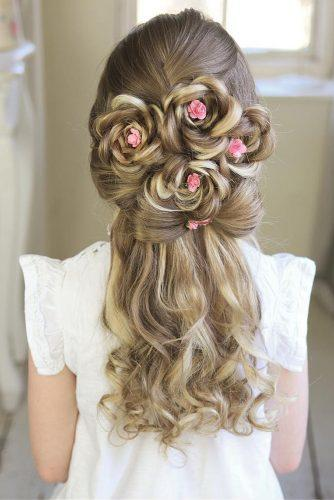 flower girl hairstyles half up half down with pink flowers sweethearts_hair via instagram