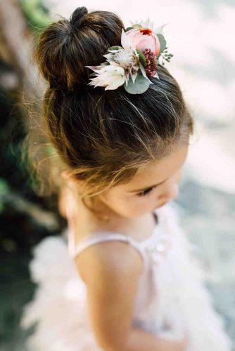 flower girl hairstyles high bun decorated with flowers plum and oak photo
