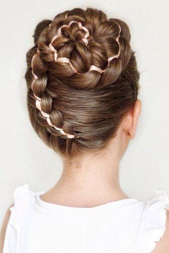 flower girl hairstyles high spiral braided bun on dark brown hair mimiamassari