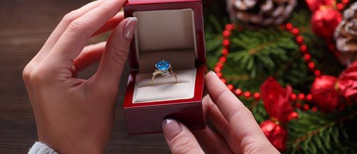 gold engagement rings box girl female hands christmas featured