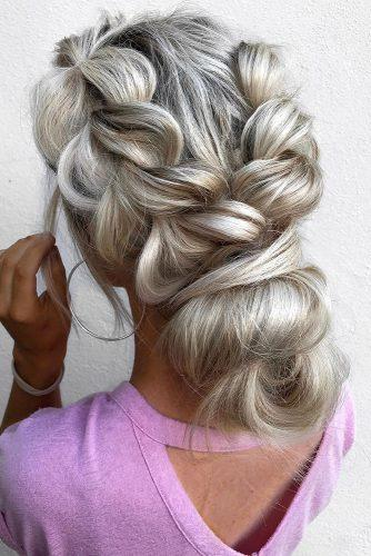 greek wedding hairstyles low bun on blonde hair with volume sides braids _hairbykinsey