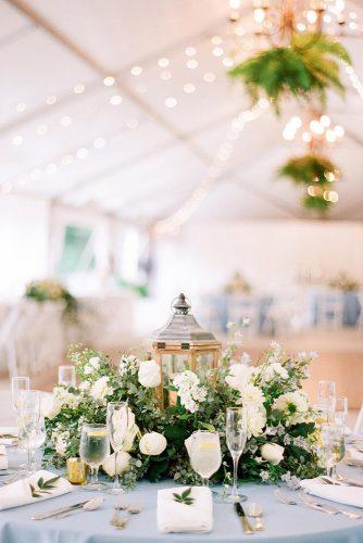 greenery wedding décor centerpiece with lantern surrounded by greenery audrawrisleyphoto