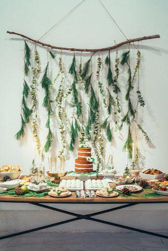 greenery wedding decor dessert table decorated with greenery wall donnaireneweddings via instagram