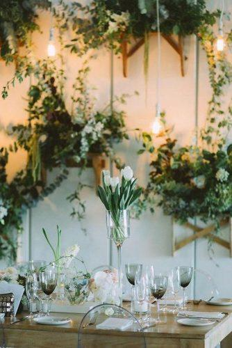 greenery wedding décor reception decorated with greenry and white tulips on table stephanieveldmanphotography