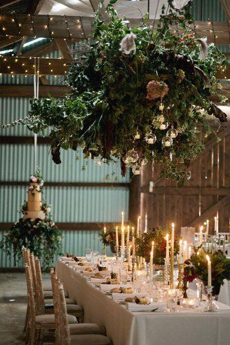 greenery wedding décor romantic reception with candles wedding cake with greens jeni smith photography