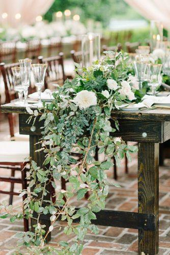 greenery wedding décor tablerunners with white flowers meredithtanton