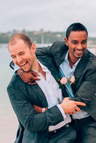 grey groomsmen suits dark with pink boutonnieres evokephoto