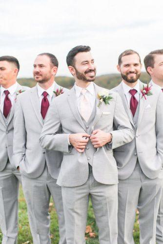 grey groomsmen suits with burgundy tie megan kelsey