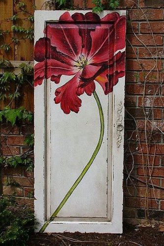 old door wedding decoration door with a painted red flower sophies place via flickr