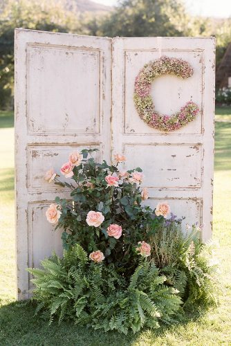 old door wedding decoration door with monogram and flowers braedon photography