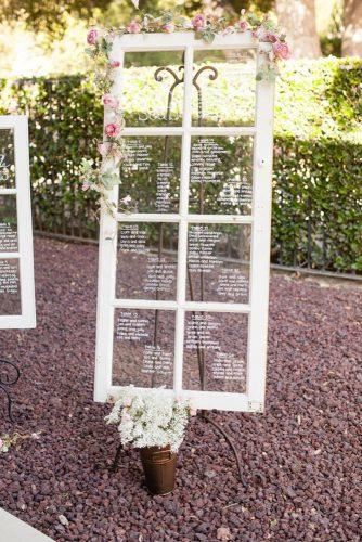 old door wedding decoration ideas table plan on a white glass door michael anthony photography