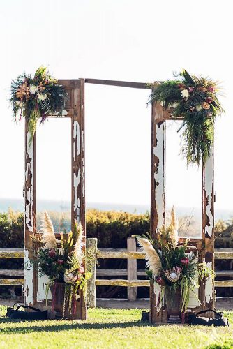 old door wedding decoration ideas the altar is decorated with flowers and greenery vitae weddings via instagram