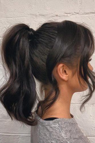 pony tail hairstyles dark hair medium length smooth with loose curls richi_grisillo