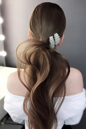 pony tail hairstyles elegant wavy on brown long hair with pearly hairpin olesya_zemskova