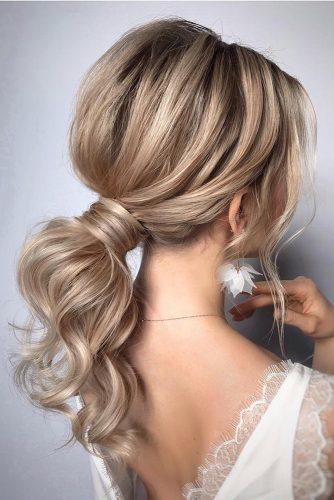 pony tail hairstyles low on blonde medium hair_vera