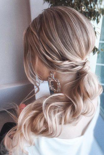 pony tail hairstyles wavy side swept on long blonde hair olesya_zemskova