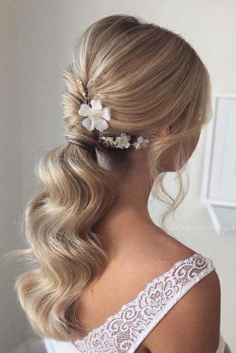 pony tail hairstyles wavy swept on blonde hair with white flower shaunaelizabethhair
