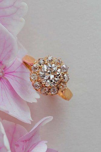 round engagement rings floral halo rose gold
