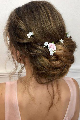 summer wedding hairstyles elegant volume low updo swept with pink flowers lalasupdos