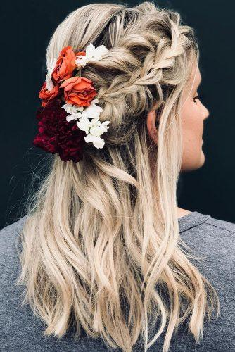 summer wedding hairstyles half up half down with braid and red orande white flowers emilyellislocksandlooks