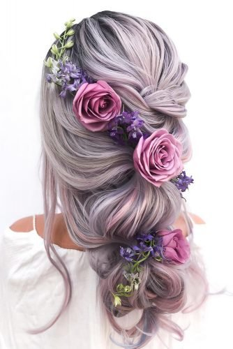 summer wedding hairstyles half up half down with curls on pink hair with roses and greenery styles_by_reneemarie