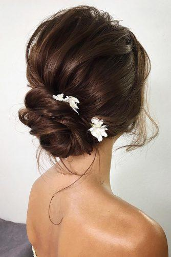 summer wedding hairstyles low bun with white flowers lenabogucharskaya