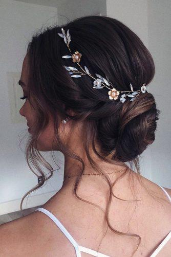 summer wedding hairstyles low chignon with flower halo muavancouver