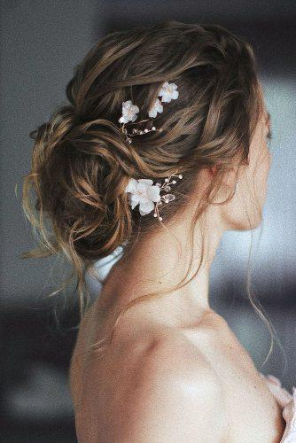 summer wedding hairstyles textured wavy bridal updo with white flower accessories ulyana.aster