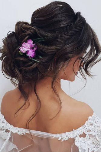 summer wedding hairstyles volume low bun on black hair with lilac flowers ksenya_makeup