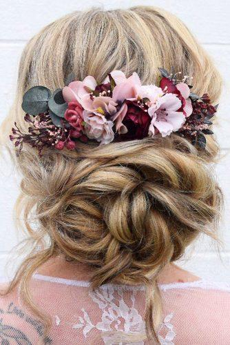 summer wedding hairstyles volume messy low bun with flowers wb_upstyles