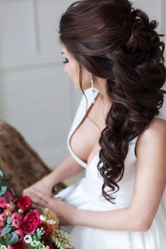 swept back wedding hairstyles cascading hair down elstile via instagra