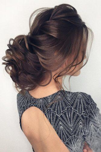 swept back wedding hairstyles dark hair low curly bun olesya_zemskova