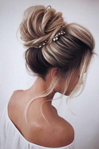 swept back wedding hairstyles high volume bun on medium blonde hair tonyastylist