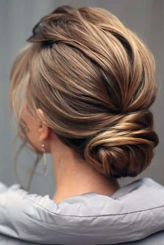 swept back wedding hairstyles low bun on blonde textured hair lenabogucharskaya